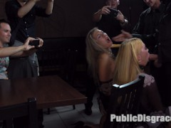 These two blondes will go to any length to please their dominant. After being publicly humiliated, Mandy and Isabella Clark are taken to a crowded bar to be used for everyone's entertainment. Issabella is striped naked and crawls along the filthy floor in a pathetic attempt to find a cock to suck. Mandy desperately needs to have her MILF ass pounded till she cant remember who she is. Propped up on a table three men take turns penetrating her asshole until it is gapping and ready for more. With a huge crowed of shocked onlookers Mandy's ass swallows a mans fist up his wrist. His feverish colon punching pushes Mandy over the edge. The crowd gasps when her fuck holes pumps with the waves of orgasms. In an attempt to not be overshadowed by Mandy's anal acrobatics, Isabella takes one cock in her sloppy cunt and another jammed into her ass. After being fully used up Isabella tilts her head back for her three load facial.video