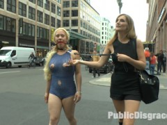 Mona Wales dislikes nothing more than dirty streets and clean submissives. This morning Mona decides to take matters into her own hands and take her beautiful blonde cum whore out to clean the streets of Berlin. The site of the humiliated Celina Davis crawling along the sidewalk is a welcome distraction to the morning commuters. Men in suits stop and admire Celina's exposed milky ass, pink pussy and spread asshole. As Mona's human street sweeper crawls to get all the trash, her heavy tits brush against the filthy sidewalk. Once Mona is satisfied that she has done her public service for the day, she takes Celina's whore holes to be fill at a local bar. Once in the bar Mona opens her slut up to be used. With an ashtray in her mouth Celina's pussy is packed of cock with a double vaginal penetration.  After Celina's holes have been completely used up the bar patrons toss their cigaret buts, ash and cum all over her face and perky tits. Thank you Mona for doing your part to make Berlin a cleaner and happier place.video
