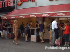 Busty blonde Luci is put on display in front of eager tourists. A group forms to watch her publicly shamed until the cops show up. Mona brings the dirty slut to a famous sausage stand where she's fully nude in front of a huge crowd. She has to stand and wait while tons of people gawk and stare. The next stop is a crowded cafe where she is tied up, blindfolded, and groped by complete strangers. After she is fed cocks and pounded in her ass and pussy, Mona gives her a final task. With a toilet brush strapped to her face, she has to clean a filthy urinal while getting cum on all over her face.video