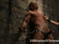 The Wall - Robert Axel begins his challenge chained to the wall as Van tears away his jock and gets his cock hard.  It doesn't take long before Robert's skin turns beat red from the impact of Van's fists.  Pulling on the bound stud's cock, Van beats him with the flogger as Robert screams in pain.  - The Pit - Robert's made to balance on a dildo shoved up his ass as clothespins are attached across his entire torso.  As each one is cropped off Robert pushes with all his might through the pain.  Van breaks out the big flogger and mercilessly beats Robert before calling in the gimp. - Gimp/Water Station - Robert is bound on his back with his feet in the air for the Gimp to plow his hole.  He endures shocks from the zapper before water is sprayed all over his face and the gimp's cum all over his balls.  After three intense challenges, Robert must finally blow his load.video