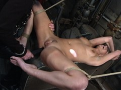 Genuine slave and Master couple Nikki and God of Fuck take us into their dirty boiler room for some strict bondage, hard anal fucking and verbal degradation. To prepare slave Nikki's ass a huge flashlight is shoved inside and then turned on for her Master's amusement. Her tits are tied tight and her face is fucked deep throat style. She gags but obediently does the best she can. Lastly, in nothing but simple shackles Nikki is taken from behind for the hardest, roughest anal fuck we have ever seen!video