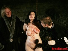 Brunette Gypsy Imprisoned for BDSM Gang Bang Gypsy, a sexy brunette fortune teller, must endure imprisonment, BDSM gang bang, domination, rope bondage and suspension, spanking, slapping, humiliation, fingering, breast, nipple and pussy torment. She\\\'s so good at her job that she saw this punishment coming.video