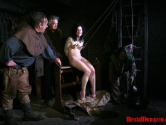 Brunette witch Loredana has been arrested and punished in our dungeon once a day. She begs for forgiveness and will do anything to earn freedom, even endure imprisonment, rope bondage, domination, BDSM fun, gang bang, clothespins play, weight hanging with a water pail, spanking, slapping, fingering, breast, nipple and pussy torment.video