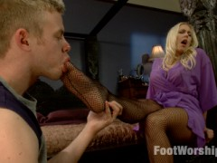 Angel Allwood can't get enough hot foot sex with her ped worshipping physical trainer. She lures him back to her place so he can lick her size six arches and suck on her fragrant fishnet stockings and perfect pink toes. She starts him out with a foot job and then fucks him hard for a series of incredible toe curling orgasms. She finishes him off by taking his cock between her sweet soles and rubbing his aching cock and balls in her foot-pussy until he cums all over her feet and toes!video