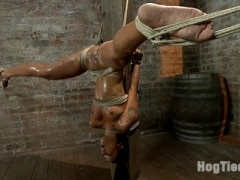 Welcome amazing sultry Skin Diamond back to HogTied.SCENE 1Skin is dragged on set by Claire and bound in a suspended hogtie with her elbows together. A nice red ball gag is shoved deep into her mouth and her head pulled back tight by hair bondage. She looks furtively around as Claire torments her. The pain heightens her pleasure. Her moans rhythmic and seductive.SCENE 2Bound against a pole, Skin is suspended upside down in an extremely challenging straddle suspension. She gets rubbed with oil and glistens, showing off all of her curves and making her breasts and ass really stand out. Claire takes note and beats her so hard with the flip cat she takes most of the oil off. The cum that we squeeze from Skin is every bit as amazing as her endurance bondage.SCENE 3With her legs above her head, Skin is bound in an upright pile driver type position with her arms tied severely above her head and secured to a spreader bar. Every position has put Skin to her limit and this one pushes her the hardest. Slicked with grease and suspended in the air she is the perfect bondage puppet squirting cum slut.SCENE 4Back on the beam, her waist is bound to her thighs pushing her amazing ass out incredibly far. Her arms are bound in reverse prayer. Her hands are tied to her wrists to keep her face up and pulled back to an extreme angle. Skin's head is back to far she can't even swallow! She takes it, hard. Skin Diamond is the best of the best... the best orgasms cum from the most challenging bondage - only on HogTied.com.video