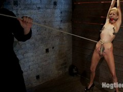Welcome Rene Phoenix back to Hogtied.  This tiny sexy blond has an amazing tight, huge nipples and a beautiful smile.Rene is made to strip down to only her sexy high heels, then she is bent over and a butt plug is jammed inside her perfect little ass.  The plug is tied in place with a tight crotch rope.  Rene suffers and suffers hard as the SGT abuse her sexy little body.  The cane is used floggers and heavily weighted nipple clamps. The shoes come off and Rene must stand on her very tippy toes or the crotch rope burns deep into her shaved slit.  Predicament bondage at its best, as Rene must use all her calf muscles or her pussy takes the brunt of her weight!video