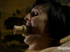 Dylan is a tough bondage whore. She whines & moans as clips & clamps are attached to her sore nipples to no avail. As she realizes that the bamboo she is bound to does not give, she resigns herself to be fucked & tormented till spent.video