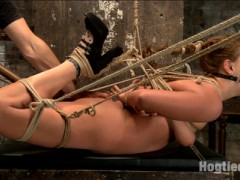 Sexy Roxy Raye loves it in the ass, and she gives up great anal orgasms in tight bondage for HogTied members. Roxy starts out in a strict, classic hogtie that only gets tougher. As the tie progresses, her thighs are tied wide apart so I can fuck her hot pussy with a dick on a stick and vibe her clit into uncontrollable orgasms.Doggie Style Anal Fuck is next up. Roxy's ass get's tied open, filled and fucked with a giant clear butt plug. Her pussy is vibed while I fuck her ass and make her come over and over in the tight doggie tie.The Squirting Shocker: tie subject tightly into inescapable bondage, jam two in the pussy, two in the ass and fuck till copious amount of pussy juice is squirted all over the floor.video