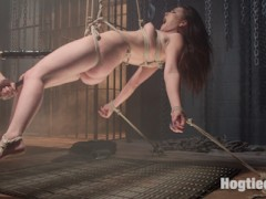 If you enjoy bondage you already know Juliette March, the pretty little pain slut from next door who can never get enough. Hogtied gives Juliette close to too much in this hardcore update featuring multiple suspensions and painful orgasms.First scene finds Juliette spread eagle on the floor getting flogged nonstop until she is hoisted into the air in a reverse backbend. With the hands and feet bound to four corners, there is nothing she can do to stop the big dildo ramming her pussy and bringing a barrage of relentless orgasms.Second scene Juliette is suspended like a little dolly in a crucifixion. Her begging eyes are almost comical as more weight and clamps are left to hang off her sensitive pink parts and tender nipples. We rip a few more screaming orgasms from this masochist before she is left hanging in the air. Third Scene we hanging Juliette's now swollen pussy at fucking height and take her for a serious ride while she is trussed up like a little package. It would not be Hogtied if we didn't feed these slutty bondage whores tip they can't take anymore. Thanks Juliette.video
