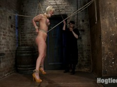 The first order of business is to get this bitch in bondage. Claire gives instructional tips as Cherry gets restrained. We move on to Cherry's gorgeous tits and watch them get bound, turning a nice shade of red. Add elbow bondage and her torso shape is stunning.Her panties get cut off and turned into a mouth packed tape gag, a very severe type of gag that can't be pushed out of the mouth, no matter how hard they try. The last item on the list is to make sure the slut can't close her legs. Beautiful, vulnerable, and statuesque.Claire applies a cruel order of corporal and clamps to the mix and moves on to the pinnacle of the position, a breast suspension and crotch rope brutal combo. Cherry gives us everything she had in this position, but we know the bitch has got more...video