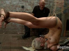 Lorelei Lee starts off her live show in one of our most brutal hogties - the pushup position! If Lorelei lowers her hands, she chokes herself with her feet tied to her neck. Closely supervised, we get to watch her live and egg her on to see how good this cum hungry whore can suck cock. She gets balls deep on Mark's cock and her bright blue eyes never leave his sight. Lapping up her spit, it just keeps pouring and foaming out of her mouth. In the second position, Claire binds her in a difficult strappado hogtie and suspends her live for you in front of the camera. Mark steps in and delivers a hard blow job that Lorelei cannot escape from. Claire and Mark then fuck her face and pussy at the same time, double stuffing Lorelei, then finishing her off in a very challenging thighs only inversion that Mark face fucks her and squeezes tight hard juicy orgasms out of Lorelei's ripe and willing cunt. In the third position, Lorelei is laced tightly into our brown leather arm binder and folded forward in to a straight legged pile driver with thighs to the ceiling. Add in bastinado to her tender feet and she is worked up into a frenzy.  In the last position, Lorelei is bound with her wrists tied behind her back at the waist, elbows together, and knees pried wide and tied to pipe. Her nipples get the worst of it. Claire ties cruel twine to them and then to a support rope, so as her head bobs up and down on Mark's cock she pulls her sensitive nipples and the twine burrows deeper into her flesh. Mark is ready to be impressed. Mark pounds his cock deep and hard into the very back of her throat making breathing impossible. She has tried desperately through the whole show to appease him, now its game time.video