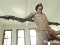Tyler Alexander has been a great addition to the Kink Men stable ever since he subbed for a room of horny gay men on Bound in Public. This 22yo is not familiar with edging but he's about to be. We put his arms back on the metal pipes, tie him up, and cut off his clothes. His uncut cock gets hard right away and we tie that up too, pulling on his balls and making him arch against the pipe. In a standing hogtie he receives a dildo in  his firm round ass . Fully suspended in the air we fuck him some more in both his holes and flog him as he swings around the room. The boy has room for more play so we throw his legs over his head and cane his ass, fuck his hole with the vibrator, and make him shoot his massive load all over his face.video