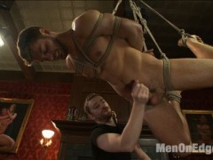 For his first time here on Men on Edge, hot straight stud Andrew Blue is a bit nervous. Andrew is blindfolded before his clothes are removed down to his underwear.  His cock begins to grow in his underwear as Sebastian teases him with his tongue. Andrew's underwear is torn off to reveal his hard cock, begging to cum.  Andrew begins to get a little feisty once he's brought to the edge a few times, so we put a ball gag in his mouth to shut him up, then beat him down with the flogger.  Bound to the bed, the stud has dildos shoved in both his holes.  The vibration on his prostate brings him to the edge once more.  Andrew can't take it and finally sprays his hot cum all over.  After having his cum smeared all over his face, we keep stroking Andrew's cock as he screams for mercy from the post-orgasmic torment.video