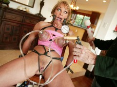 Jet Lagged Slut Wants To Get Fucked Shayla Laveaux takes time away from her family to go off and fulfill her fantasies as a total fucking whore! This busty blonde and sexually thrived MILF has an urgency to satisfy her bondage curiosity. We strap in a spider gag in her mouth and tie her up with black rope, busting out her huge tits and begging for more, we hooked up those hard nipples to a few sucction hoses and pumped up the pressure on her clit. She squirms and shakes and gets a huge load in her mouth after getting tied up and fucked hard...video