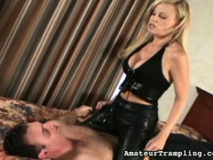 The woman in this trampling video insults a man while slapping his face, then spits on his face, and then spits into his open mouth. After that, she canes his bare bottom and contues doing so till his ass is brightly reddened. His reddened buns are testament to the fact that she not only likes to trample but likes to spank, too. After that she tramples on him, both barefoot and with shoes on, and demands that he lick her feet, again both while they are bare and while they are shod. Then she slaps his cheeks with her bare foot.video