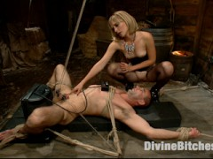 Divine Bitches announces the on screen debut of real life dominatrix Mona Wales.  A true sadist, Miss Mona revels in causing her victims pain.  Strict bondage, flogging, cropping, zapping, CBT, and a painful and humiliating strap-on ass fucking make Mona hot.  With a Sybian in his ass and his balls clipped to the ceiling, Miss Mona rides her bitch boy's face, getting off on the screams from the torturous pain she inflicts.video
